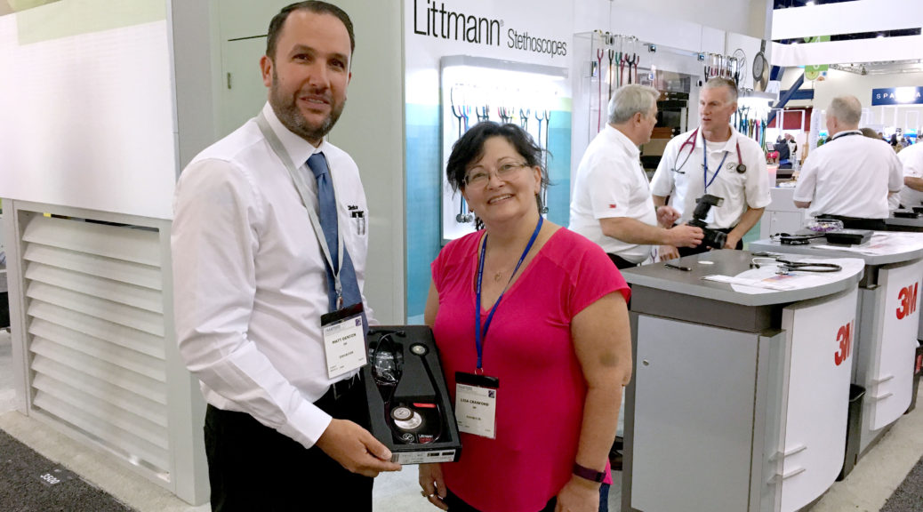 Lisa Littmann Cranford with Matt Denton receiving her new stethoscope